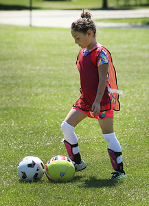 Candace H. Johnson-For Shaw Media Zaynab Shebley, 8, of Gurnee brings the balls back to a game played during the Chicago Fire Soccer Camp at Viking Park in Gurnee. The camp was sponsored by the Gurnee Park District.(7/10/18)