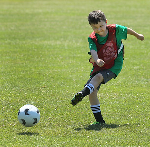 Candace H. Johnson-For Shaw Media Dominick Martinez, 8, of Gurnee kicks the ball in a game during the Chicago Fire Soccer Camp at Viking Park in Gurnee. The camp was sponsored by the Gurnee Park District.(7/10/18)