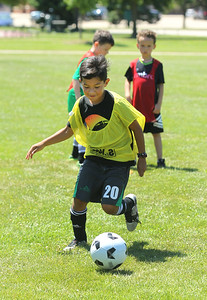 Candace H. Johnson-For Shaw Media Jayden Salinas, 8, of Gurnee works on dribbling the ball during a drill at the Chicago Fire Soccer Camp at Viking Park in Gurnee. The camp was sponsored by the Gurnee Park District.(7/10/18)
