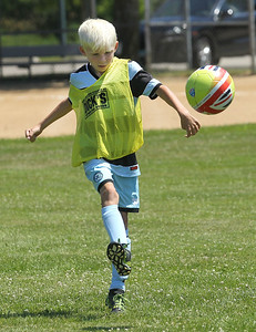 Candace H. Johnson-For Shaw Media Oliver Gross, 9, of Gurnee shoots and scores in a game during the Chicago Fire Soccer Camp at Viking Park in Gurnee. The camp was sponsored by the Gurnee Park District.(7/10/18)