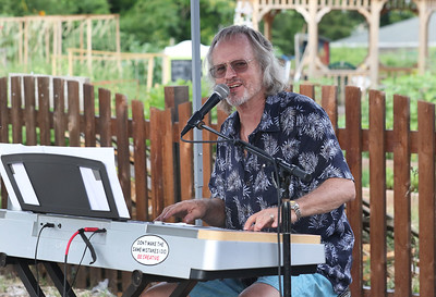 "Candace H. Johnson-For Shaw Media Michael Lescher, of Fox Lake, singer and keyboardist, plays the song, ""Boogie Woogie Bugle Boy,"" on his electric piano as he entertains the crowd at the Fox Lake Farmers Market at the Community Garden Green on 17 E. School Court in Fox Lake. The farmers market runs on Tuesdays from 4-8 pm. (7/10/18)"