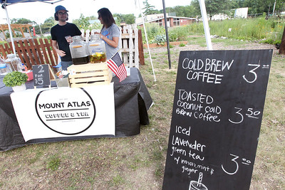 Candace H. Johnson-For Shaw Media Steven and Paola Smith, of Wadsworth wait for customers at their all organic Mount Atlas Coffee & Tea booth at the Fox Lake Farmers Market at the Community Garden Green on 17 E. School Court in Fox Lake. The farmers market runs on Tuesdays from 4-8 pm. (7/10/18)