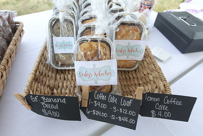 Candace H. Johnson-For Shaw Media Carly Hall, of Crystal Lake with Carly's Kolaches sells homemade banana bread, coffee cake loaf and lemon coffee cake at the Fox Lake Farmers Market at the Community Garden Green on 17 E. School Court in Fox Lake. The farmers market runs on Tuesdays from 4-8 pm. (7/10/18)