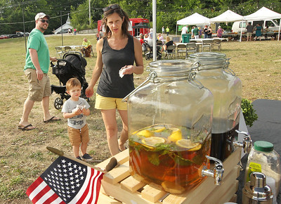 Candace H. Johnson-For Shaw Media Jon and Erin Aunet, of Ingleside and their children Emerett, two-weeks-old, and Eliassen, 2, visit the Mount Atlas Coffee & Tea booth at the Fox Lake Farmers Market at the Community Garden Green on 17 E. School Court in Fox Lake. The farmers market runs on Tuesdays from 4-8 pm. (7/10/18)