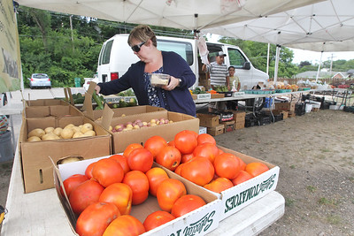 Candace H. Johnson-For Shaw Media Patty Nilles, of Fox Lake checks out the fresh produce offered by Six Generations Farmin' Local at the Fox Lake Farmers Market at the Community Garden Green on 17 E. School Court in Fox Lake. The farmers market runs on Tuesdays from 4-8 pm. (7/10/18)