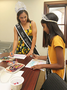 Candace H. Johnson-For Shaw Media Newly crowned Grayslake 2018 queens Mary Kate Morris, 18, and Sharanya Sahu, 8, color a Happy Birthday craft during the Saturday Kids! program celebrating the 200th anniversary of statehood for Illinois at the Grayslake Heritage Center & Museum in Grayslake. The Saturday Kids! program takes place on the second Saturday of each month. (7/14/18)