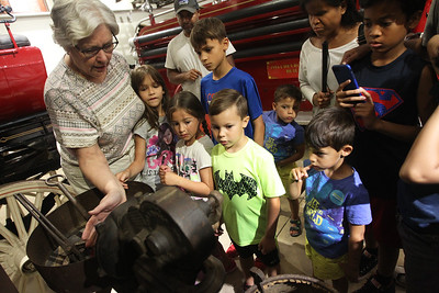 Candace H. Johnson-For Shaw Media Linda Willhite, of Grayslake shows a group of children and their parents a forge in the Annex during the Saturday Kids! program celebrating the 200th anniversary of statehood for Illinois at the Grayslake Heritage Center & Museum in Grayslake. Willhite is vice president of the Grayslake Historical Society. The forge was presented to talk about the history of the blacksmiths who used to work in Grayslake.(7/14/18)