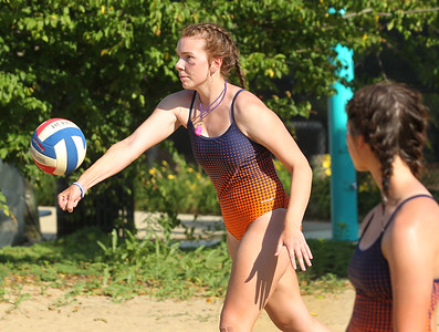 Candace H. Johnson-For Shaw Media Gurnee Park District's Emma Brady, 17, serves as Victoria Kurisu, 16, both of Grayslake watches as they play in a volleyball game against another Gurnee Park District team during the Lifeguard Games at the Hunt Club Park Aquatic Center in Gurnee. The Gurnee Park District hosted the event.(7/11/18)