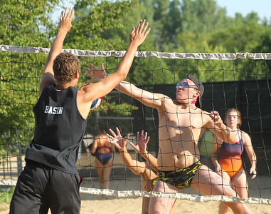 Candace H. Johnson-For Shaw Media Gurnee Park District's Timothy Schenk, 16, of Wadsworth tries to save the block from Deerfield Park District's David Basin, 17, of Deerfield, during their volleyball game for the Lifeguard Games at the Hunt Club Park Aquatic Center in Gurnee. The Gurnee Park District hosted the event.(7/11/18)