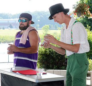 Candace H. Johnson-For Shaw Media Shane Ferree, of Round Lake Beach volunteers to help magician Dynamic Dylan, of Antioch with a magic trick at his performance during BeachFest at the Cultural & Civic Center in Round Lake Beach.(7/14/18)
