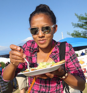 Candace H. Johnson-For Shaw Media Emma Sina, of Hainesville eats a pupusas from Pupusita Express during BeachFest at the Cultural & Civic Center in Round Lake Beach.(7/14/18)