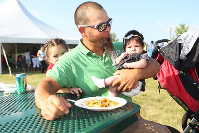 Candace H. Johnson-For Shaw Media J. Felix Castellanos, of Hainesville enjoys some festival food with his daughters, Genesis, 5, and Fatima, two-months-old, during BeachFest at the Cultural & Civic Center in Round Lake Beach.(7/14/18)
