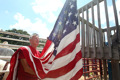 Candace H. Johnson-For Shaw Media Steve Boehmer, of Wauconda gets ready to raise the American flag during the 55th Annual Wauconda Rodeo at the Golden Oaks Equestrian Center in Wauconda.The event was sponsored by the Wauconda Chamber of Commerce. Boehmer has worked at the rodeo for forty years. (7/15/18)