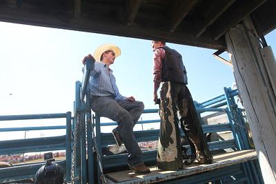 Candace H. Johnson-For Shaw Media Chasen Lane Thrasher, of Columbia, Tenn., talks with Corey Bailey, of Buchanon, Tenn., before he competes in Bull Riding during the 55th Annual Wauconda Rodeo at the Golden Oaks Equestrian Center in Wauconda.The event was sponsored by the Wauconda Chamber of Commerce. (7/15/18)
