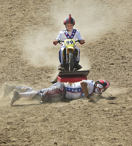 Candace H. Johnson-For Shaw Media Jayson DeBaeke, 9, of Houghton Lake, Mich., uses a dirt bike to ride high over his father, Chris, as they entertain the crowd during the 55th Annual Wauconda Rodeo at the Golden Oaks Equestrian Center in Wauconda.The event was sponsored by the Wauconda Chamber of Commerce. (7/15/18)
