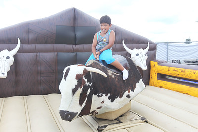 Candace H. Johnson-For Shaw Media Isaac Fierro, 8, of Round Lake rides a mechanical bull during the 55th Annual Wauconda Rodeo at the Golden Oaks Equestrian Center in Wauconda.The event was sponsored by the Wauconda Chamber of Commerce. (7/15/18)