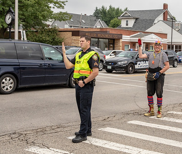A McHenry Police office gets help directing traffic Sunday, July 22, 2018 during the annual Fiesta Days Parade in McHenry. KKoontz – For Shaw Media