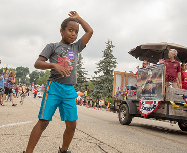 Richard Taylor-Terry ( 7yrs) from Ringwood enjoys the Fiesta Days Parade in McHenry Sunday, July 22, 2018. KKoontz – For Shaw Media