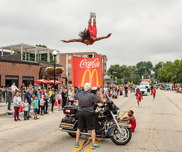 The Jessie White Tumblers thrill the crowd Sunday, July 22, 2018 during the Fiesta Days Parade in McHenry. KKoontz – For Shaw Media
