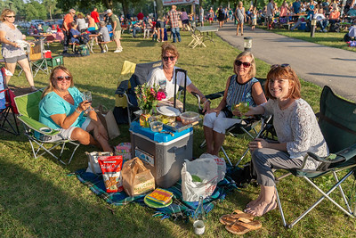 Pat Pfaller, Debbie Cherney, Tia Poggansee and Anne Iscra enjoy a nice summer evening at Main Beach in Crystal Lake Tuesday, July 24, 2018 watching R-Gang, an R&B Motown band from Chicago. KKoontz – For Shaw Media