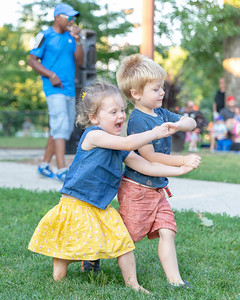 Carson Scheppman (3) and Grace Everly (3) show off their dance moves at during Concerts on the Park at Main Beach in Crystal Lake Tuesday, July 24, 2018. KKoontz – For Shaw Media