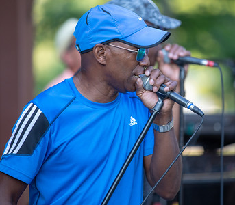 Rob Davis, lead singer of R-Gang, an R&B Motown band from Chicago, performs at Concerts at the Park at Main Beach in Crystal Lake Tuesday, July 24, 2018. KKoontz - For Shaw Media