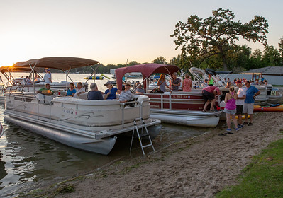 Boats line the beach at Main Beach in Crystal Lake to listen to the Chicago band R-Gang Tuesday, July 24, 2018. KKoontz – For Shaw Media
