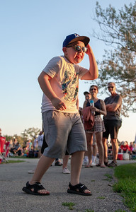 Colten Solas, (7) from Crystal Lake Struts his stuff at Concerts on the Park held at Main Beach in Crystal Lake Tuesday, July 24, 2018.  KKoontz – For Shaw Media