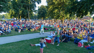 Area residents enjoy a summer evening at Main Beach in Crystal Lake Tuesday, July 24, 2018 enjoying the sounds of R-Gang, an R&B Motown band from Chicago.  KKoontz – For Shaw Media