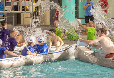As part of the YMCA 2018 Corporate Challenge, area teams compete in canoe battleship Thursday, July 26, 2018 at the Sage YMCA in Crystal Lake. The object is to sink your opponent's canoe using buckets of water. KKoontz- for Shaw Media