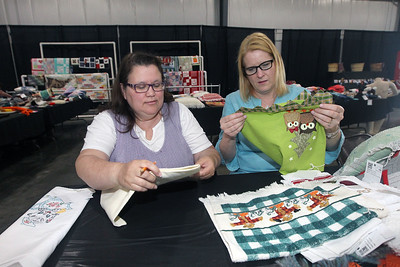 Candace H. Johnson-For Shaw Media Mary Wyatt, of Mundelein and Moanna Mower, of Long Grove judge textiles in the towels embroidered or cross-stitch category in the Expo Hall before the start of the Lake County Fair at the Lake County Fairgrounds in Grayslake. (7/23/18)