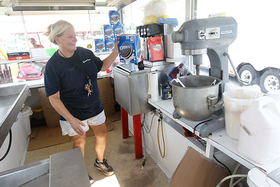 Candace H. Johnson-For Shaw Media Beth Tapp, of Landis, N.C., owner of Beaver Concessions, gets her Oreo cookie supply ready to fry before the start of the Lake County Fairgrounds in Grayslake.Tapp sells elephant ears, funnel cakes, deep fried funnel cakes, cookie dough, oreos and pickels. (7/24/18)