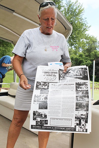 Candace H. Johnson-For Shaw Media Jennifer Monday, of McHenry talks about a poster featuring houses that were for sale in the 1930's after she gave a Historic Pontoon Boat Tour of Island Lake. Monday is a docent with the Historical Society of Island Lake.(7/21/18)