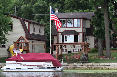 Candace H. Johnson-For Shaw Media One of the houses featured on the Historic Pontoon Boat Tour of Island Lake has a flagpole with a ball on top which came from the Chicago World's Fair in the 1930's. (7/21/18)