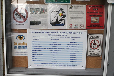Candace H. Johnson-For Shaw Media An Island Lake slot and daily creel regulations sheet is on display at Eastway Park for people who like to fish in Island Lake. (7/21/18)