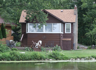 Candace H. Johnson-For Shaw Media An original log cabin built in the 1930's is featured during the Historic Pontoon Boat Tour of Island Lake. (7/21/18)