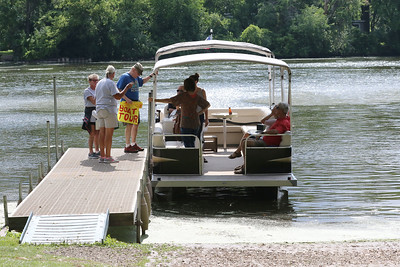 Candace H. Johnson-For Shaw Media Visitors get on a pontoon boat at Eastway Park to take a Historic Pontoon Boat Tour of Island Lake.The tour is hosted by the Historical Society of Island Lake. (7/21/18)