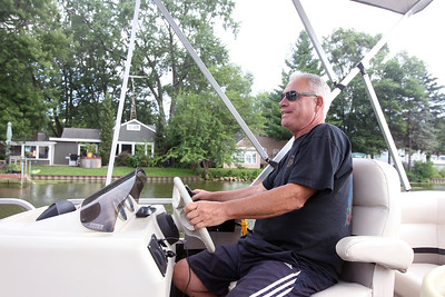 Candace H. Johnson-For Shaw Media Jeff Stenton, of Island Lake drove his pontoon boat for a group of people taking the Historic Pontoon Boat Tour of Island Lake.(7/21/18)
