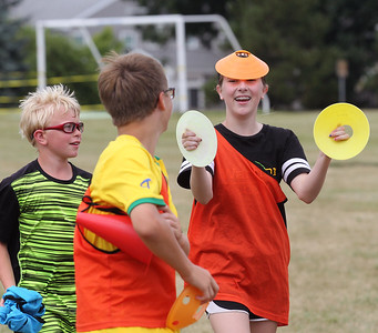 Candace H. Johnson-For Shaw Media Kyle Knodell, 11, of Lindenhurst and Ethan Schwartz, of Lake Villa watch Dakota Snow, of Antioch, both 13,  have fun with a cone on her head during the Lindenhurst Park District's TetraBrazil Soccer Camp at Millenium Park in Lindenhurst. (7/19/18)