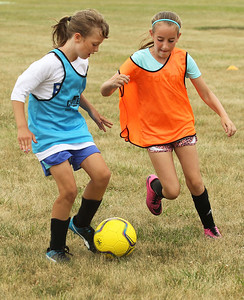 Candace H. Johnson-For Shaw Media Joli Wiedrich, of Lindenhurst battles for control with Aubrey Dickey, of Antioch, both 10, in a scrimmage game during the Lindenhurst Park District's TetraBrazil Soccer Camp at Millenium Park in Lindenhurst. (7/19/18)