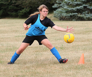 Candace H. Johnson-For Shaw Media Sabrina Nassar, 13, of Lindenhurst reaches to stop a shot on goal as she plays in a scrimmage game during the Lindenhurst Park District's TetraBrazil Soccer Camp at Millenium Park in Lindenhurst. (7/19/18)
