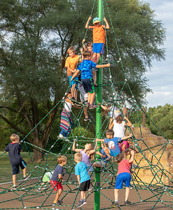 Area children enjoy the new climbing tower Thursday, July 26, 2018 at the dedication of the new public playground at the Sage YMCA in Crystal Lake.   KKoontz – For Shaw Media