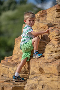 Toran McElroy (4) makes quick work of the rock-wall slide Thursday, July 26, 2018 at the dedication of the new public playground at the Sage YMCA in Crystal Lake. KKoontz – For Shaw Media
