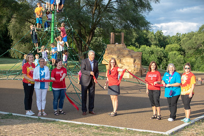 Scott Brown, former CEO of Sage Products was on hand to cut the ceremonial ribbon Thursday, July 26, 2018 at the dedication of the new public playground at the Sage YMCA in Crystal Lake.   KKoontz – For Shaw Media