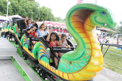 Candace H. Johnson-For Shaw Media Children enjoy the Cobra ride during Antioch's Taste of Summer in downtown Antioch. The event was hosted by the Antioch Chamber of Commerce. (7/22/18)