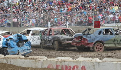 Candace H. Johnson-For Shaw Media Drivers compete in the sub-compact small cars Demolition Derby as they entertain the crowd at the 90th Annual Lake County Fair at the Lake County Fairgrounds in Grayslake.The event was sponsored by Master Truck & Trailer.