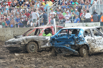 "Candace H. Johnson-For Shaw Media Mike ""Spike"" Skodacek, of Elgin fights to the finish against Laurie Stevens with McClure's Garage in the subcompact small cars Demolition Derby during the 90th Annual Lake County Fair at the Lake County Fairgrounds in Grayslake.The derby was sponsored by Master Truck & Trailer."