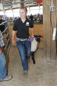 Candace H. Johnson-For Shaw Media Sara Fisher, 15, of Zion is all smiles after showing her lamb, Lily, at the 4-H Livestock Auction during the 90th Annual Lake County Fair at the Lake County Fairgrounds in Grayslake.