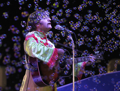 Candace H. Johnson-For Shaw Media Jim Irizarry (as John Lennon), sings with the Beatles tribute band, American English, amongst the bubbles during their Sgt.Pepper set of songs during the 90th Annual Lake County Fair at the Lake County Fairgrounds in Grayslake.