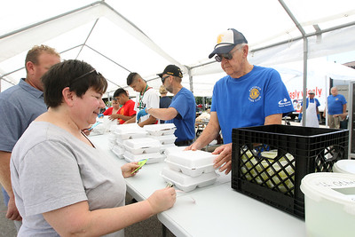 Candace H. Johnson-For Shaw Media Margaret Ellsworth, of Lindenhurst gets some BBQ chicken dinners from Dr. Al Bucar, of Antioch during the Antioch Lions Club Chicken BBQ, Pig Roast & Auction at Williams Park in Antioch.(7/29/18)